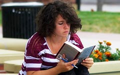 Person reading on campus