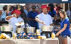 Barilla restaurant workers serve food at open house