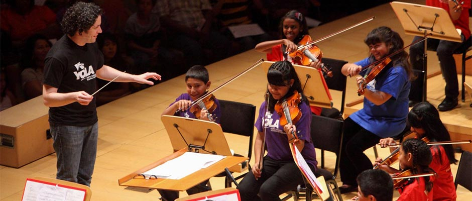 Gustavo Dudamel, conductor of the Los Angeles Philharmonic, leads the Youth Orchestra of Los Angeles.