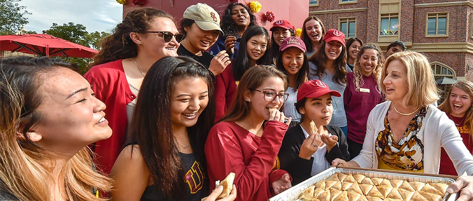 Niki C. Nikias brings Greek pastries to the USC Helenes on Thursday during their vigil guarding Hecuba