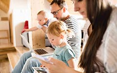 Family using web-connected devices