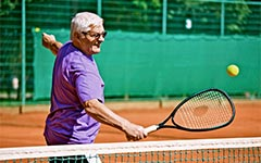 Image: Older person playing tennis