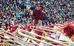 Arthur Bartner directs the Trojan Marching Band at Notre Dame